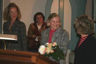Marjorie Walters receives her award from Tania Werbisky of the state Preservation League. At left is Otsego 2000 Vice President Nicole Dillingham and, in the rear, Executive Director Robin Krawitz.